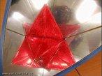 Imagem virtual de um poliedro obtida a partir de um caleidoscópio. Aqui temos uma estrela octangula no caleidoscópio do cubo.